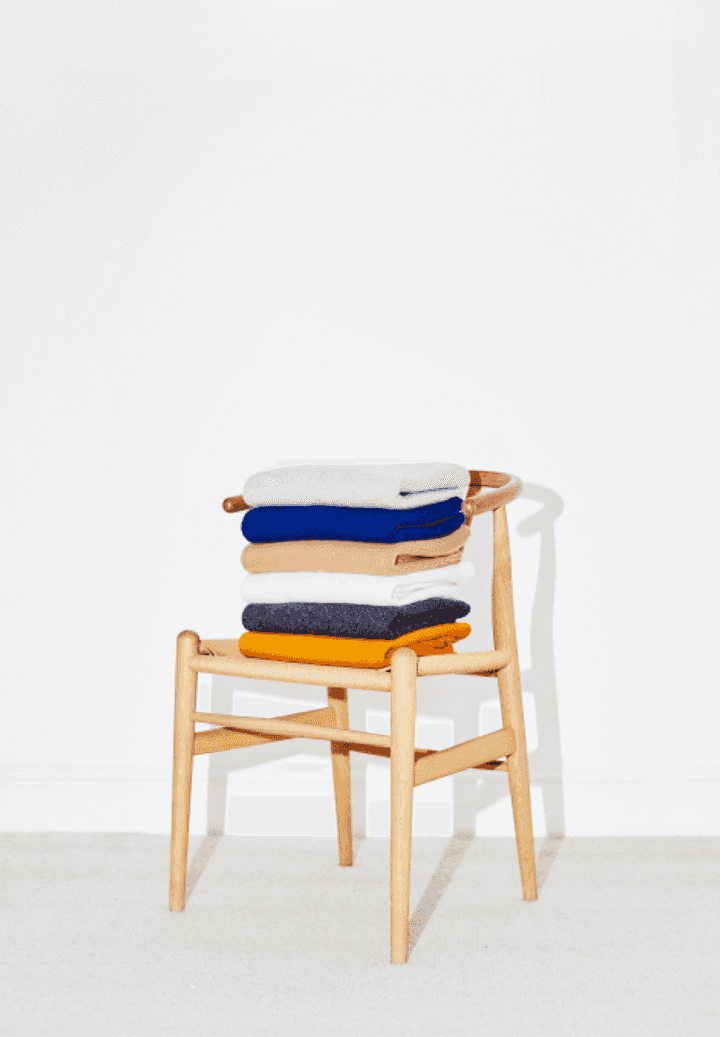 Stacked jumpers on a chair