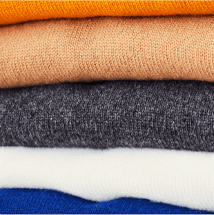 Colorful stack of jumpers